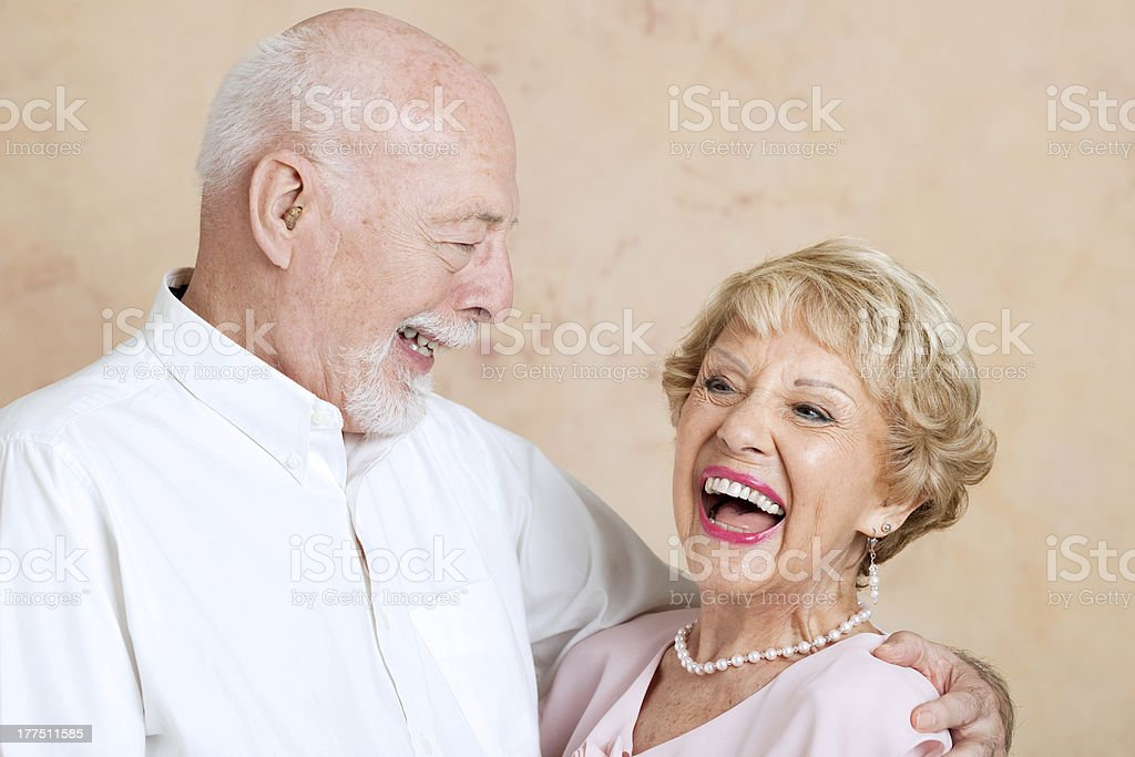 Seniors Laughing Together stock photo