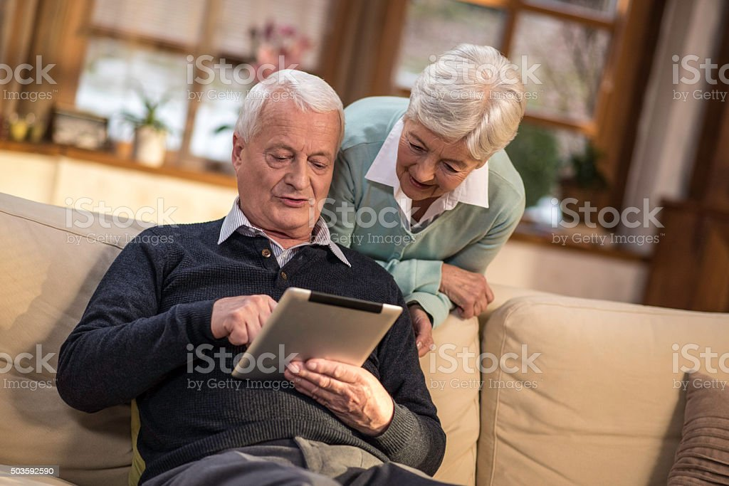 Seniors learning to use digital tablet stock photo