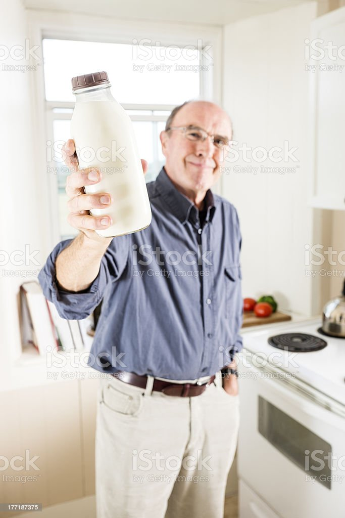 Seniors need to drink milk stock photo