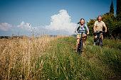Seniors on Mountain Bikes in the Countryside