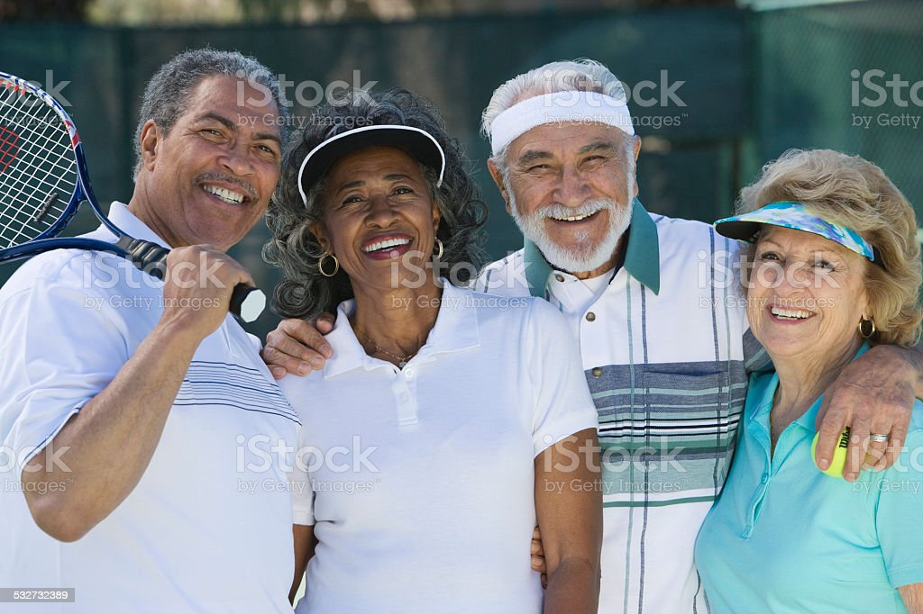 Seniors on the Tennis Court stock photo