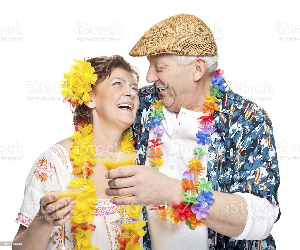 Seniors on vacation drinking cocktails royalty-free stock photo