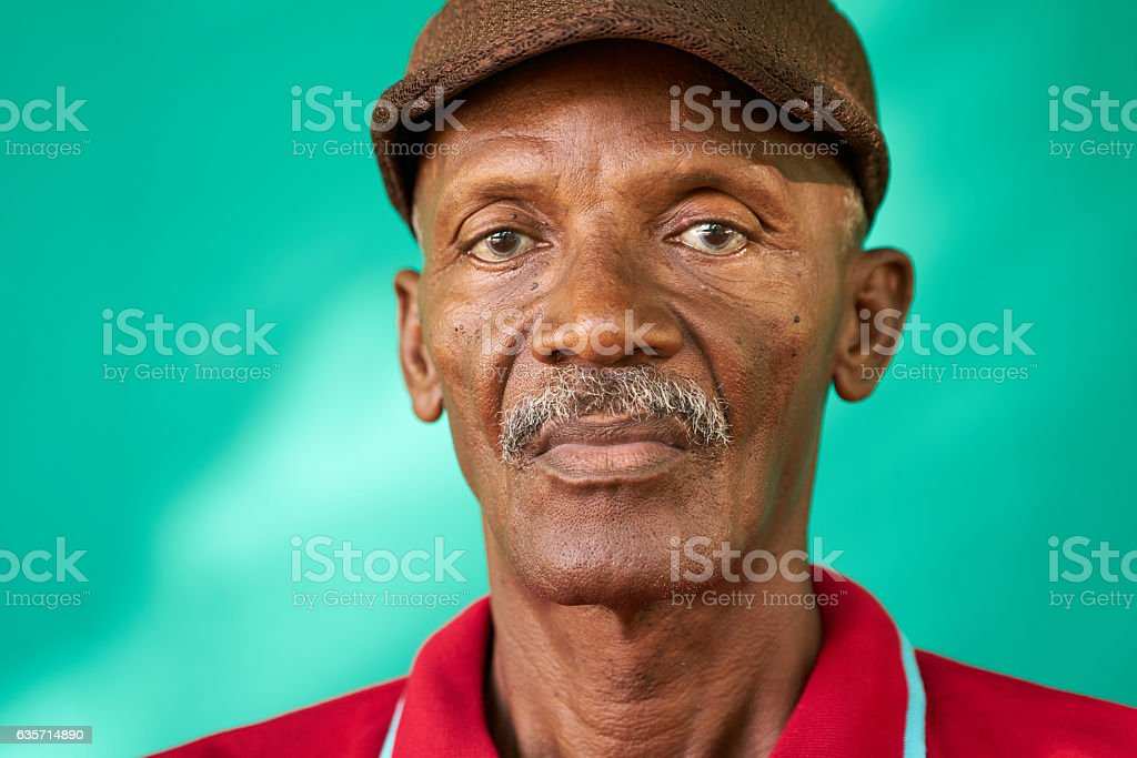 Seniors People Portrait Sad Old Black Man With Hat stock photo