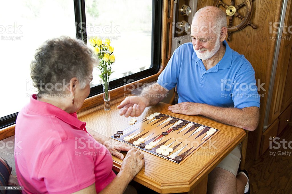 RV Seniors Playing Board Game royalty-free stock photo