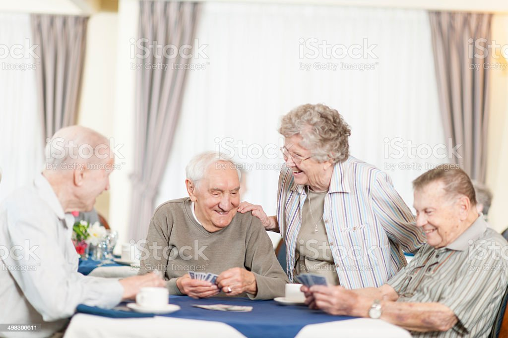 Seniors playing cards stock photo