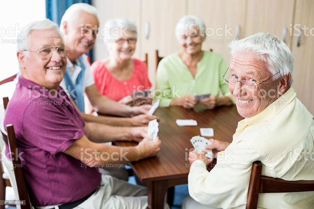 Seniors playing cards together stock photo