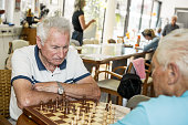 Seniors Playing Chess in an Elderly Daycare Center