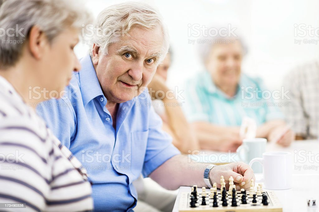 Seniors playing chess. royalty-free stock photo
