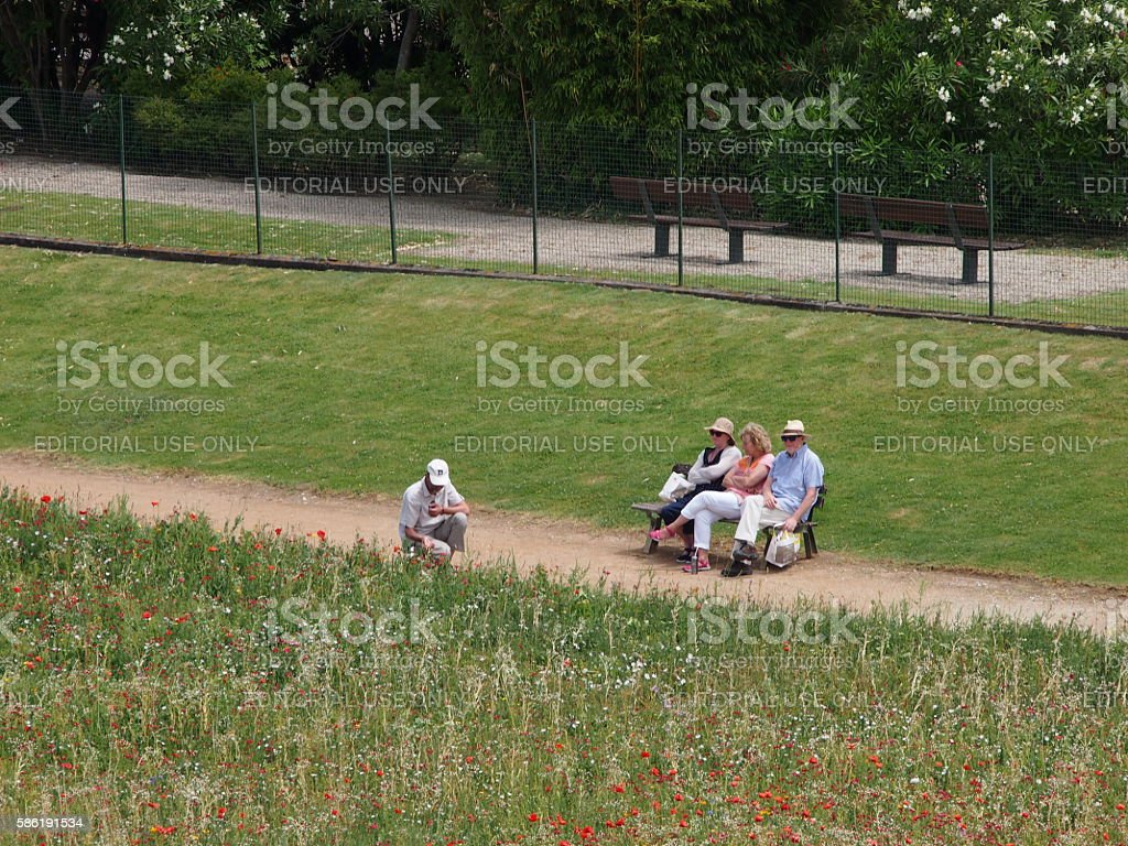 Seniors relax by the river stock photo