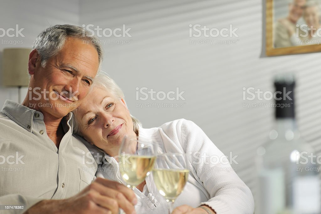 seniors relaxing enjoying wine royalty-free stock photo