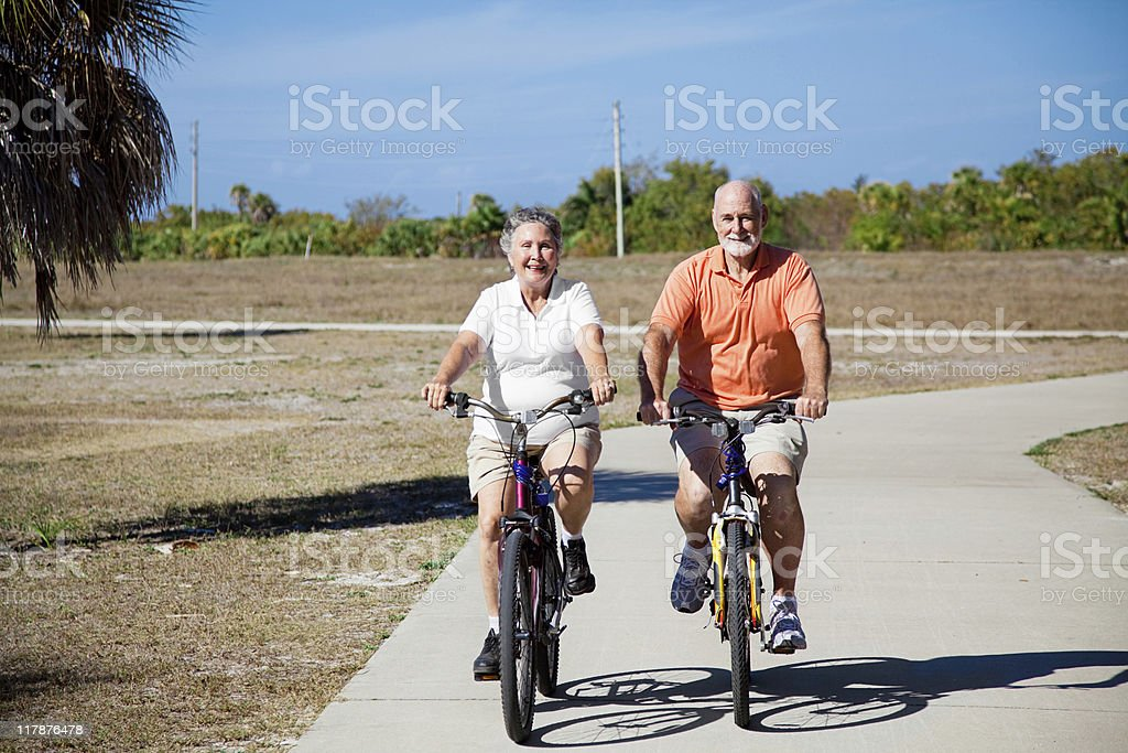 Seniors Riding Bicycles royalty-free stock photo