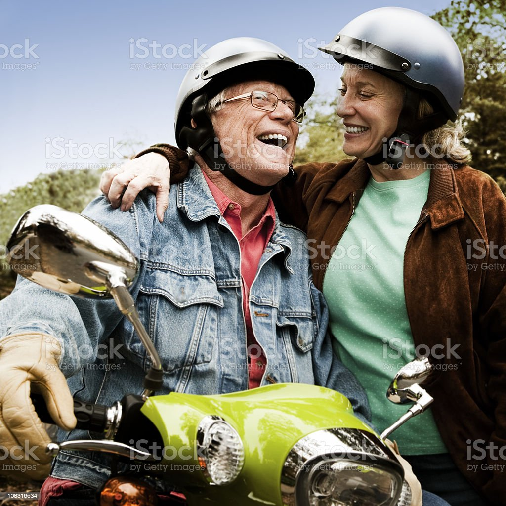 Seniors Riding Scooter stock photo