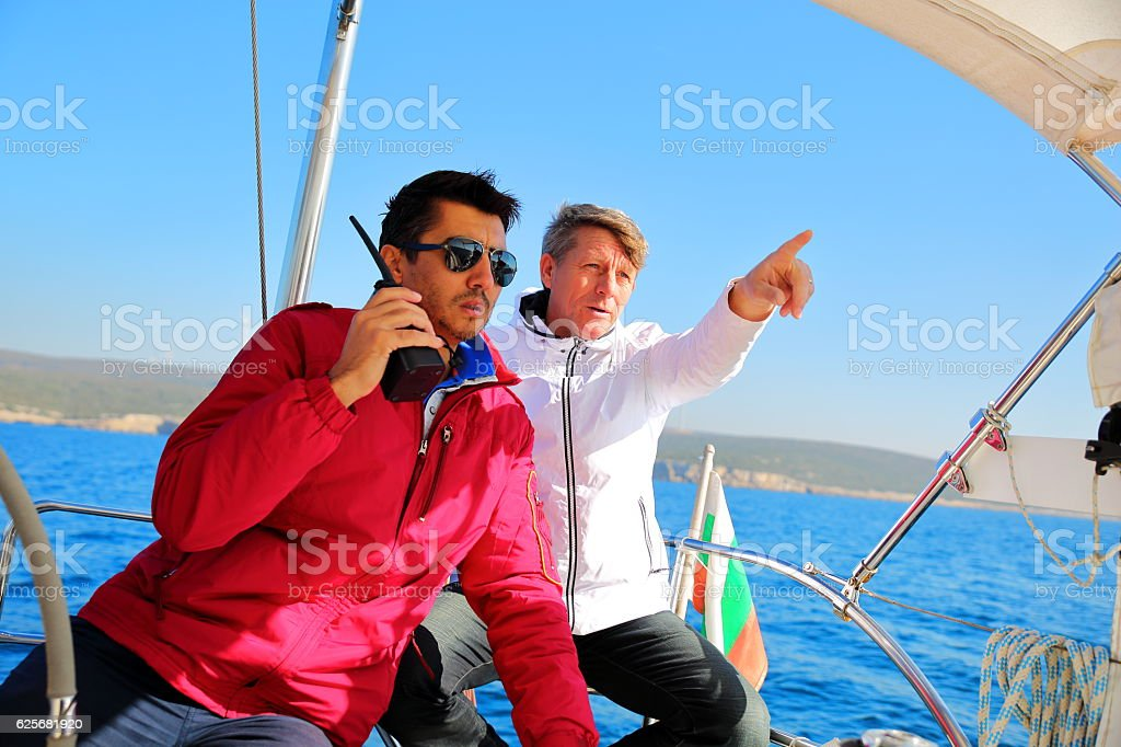 Seniors skipper sailing with sailboat stock photo