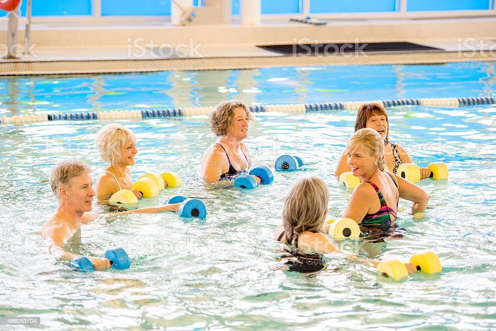 Seniors Taking a Water Aerobic Class stock photo