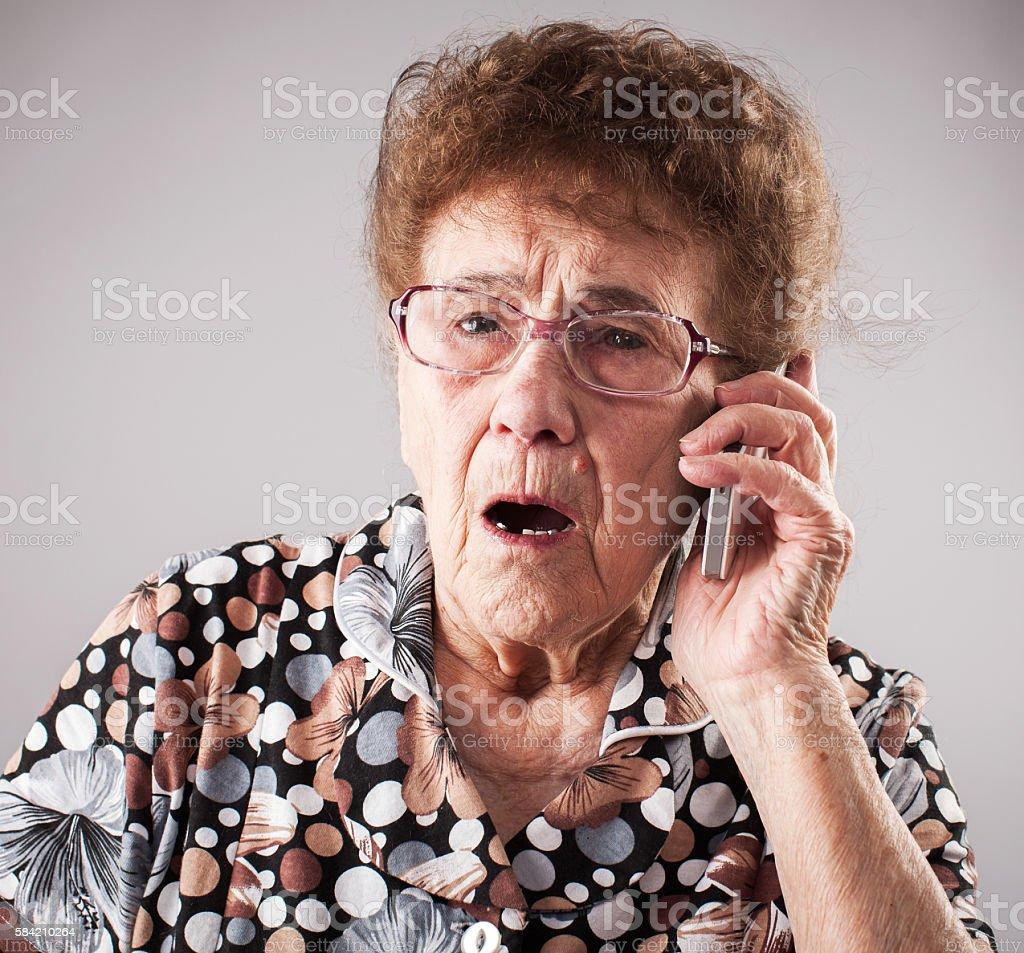 Seniors talking mobile phone stock photo