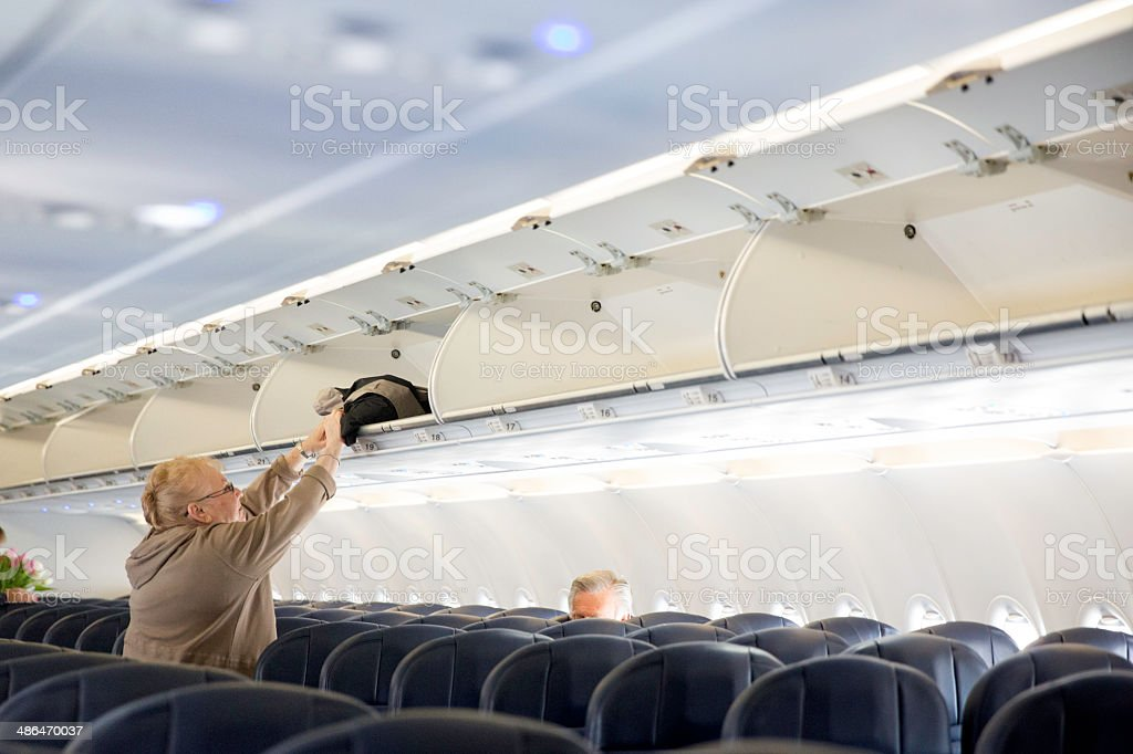 Seniors traveling by plane stock photo