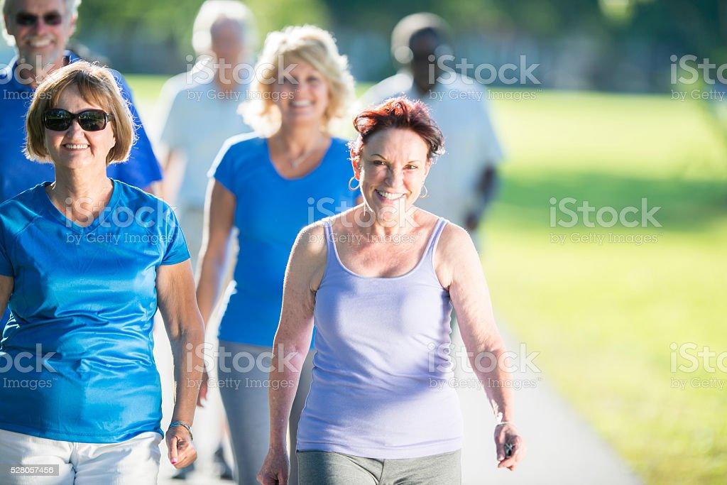 Seniors Walking in the Sun stock photo