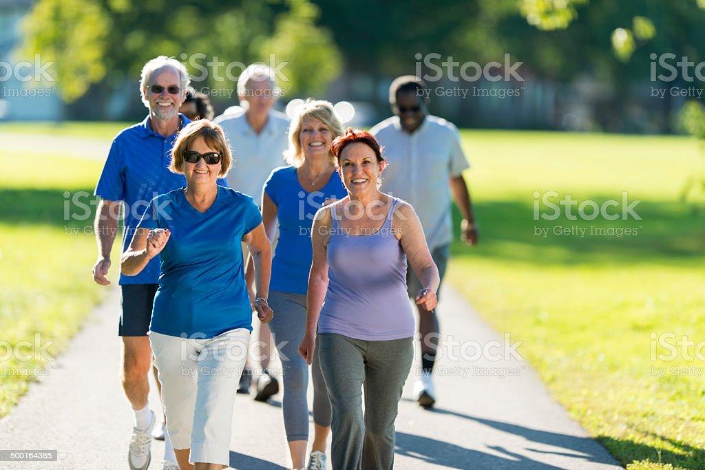 Seniors Walking stock photo