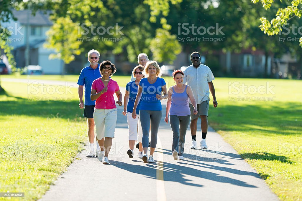 Seniors Walking stock photo