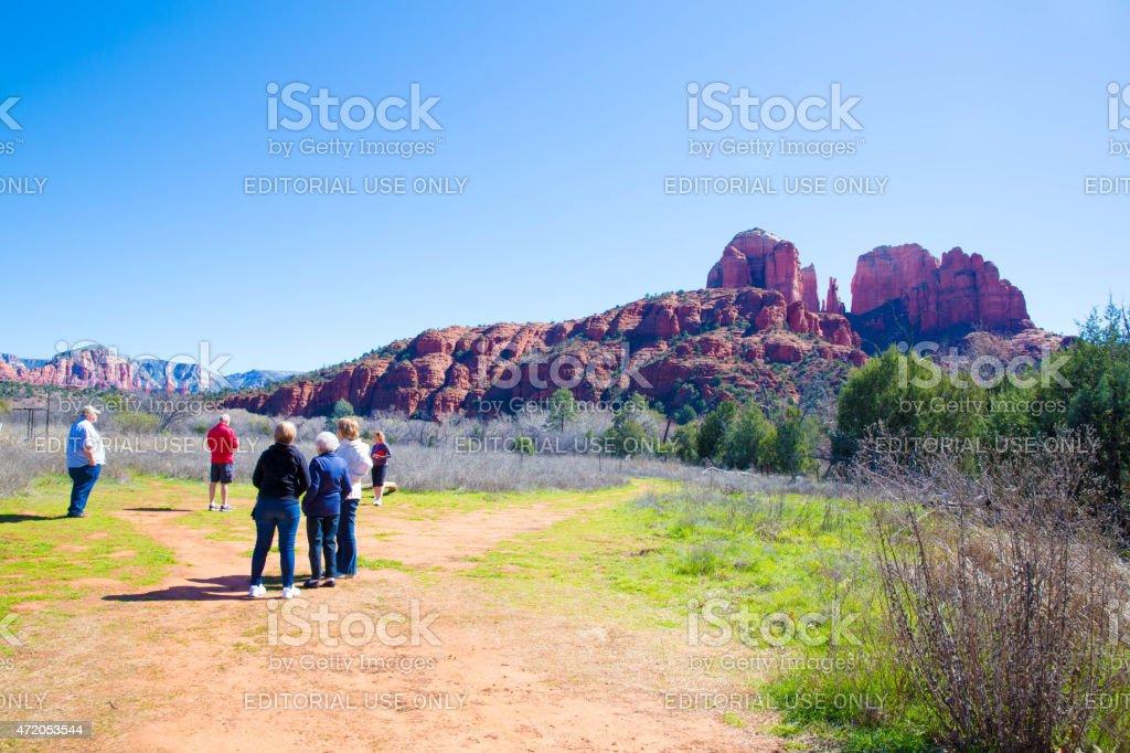 Seniors walking towards rock formations in Sedona, Arizona stock photo