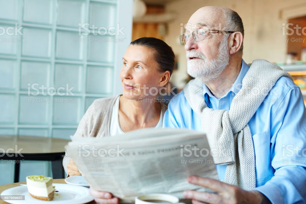 Seniors with newspaper stock photo