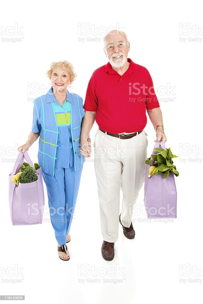 Seniors With Reusable Shopping Bags royalty-free stock photo