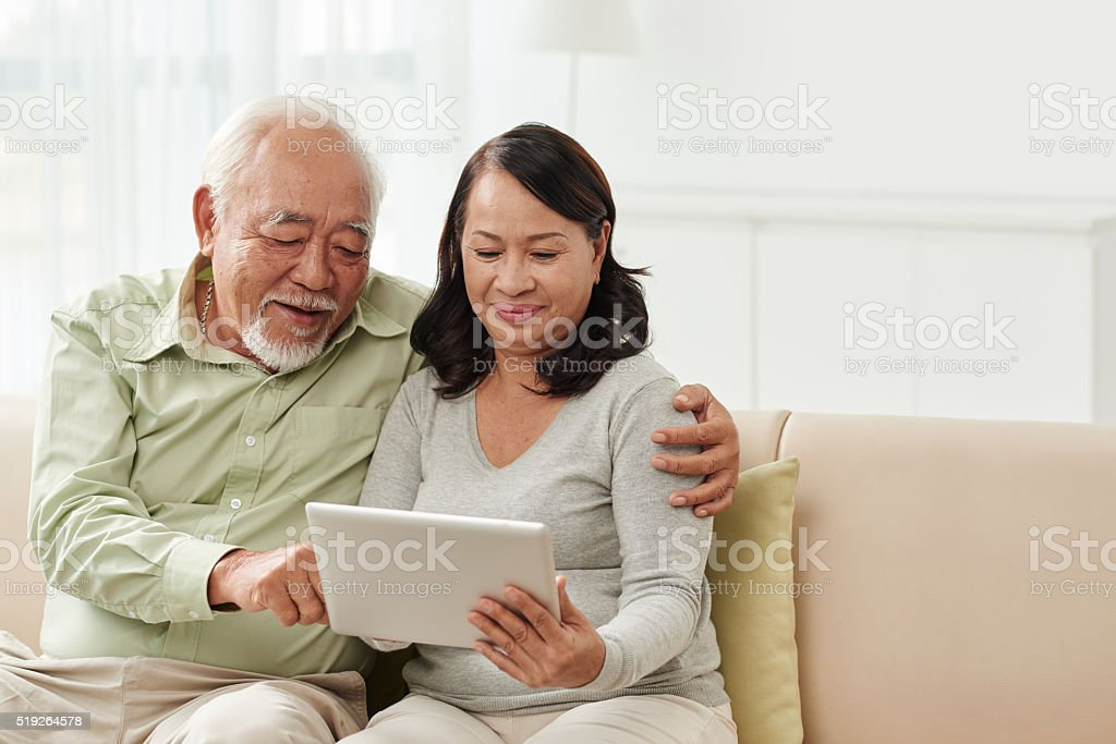 Seniors with tablet stock photo