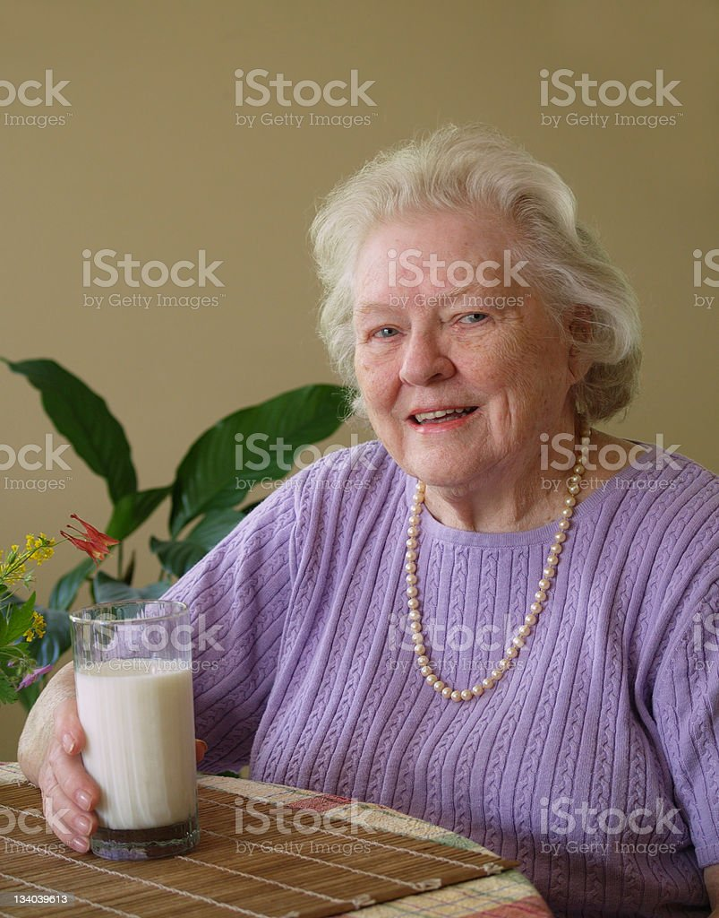 Senoir woman with milk royalty-free stock photo