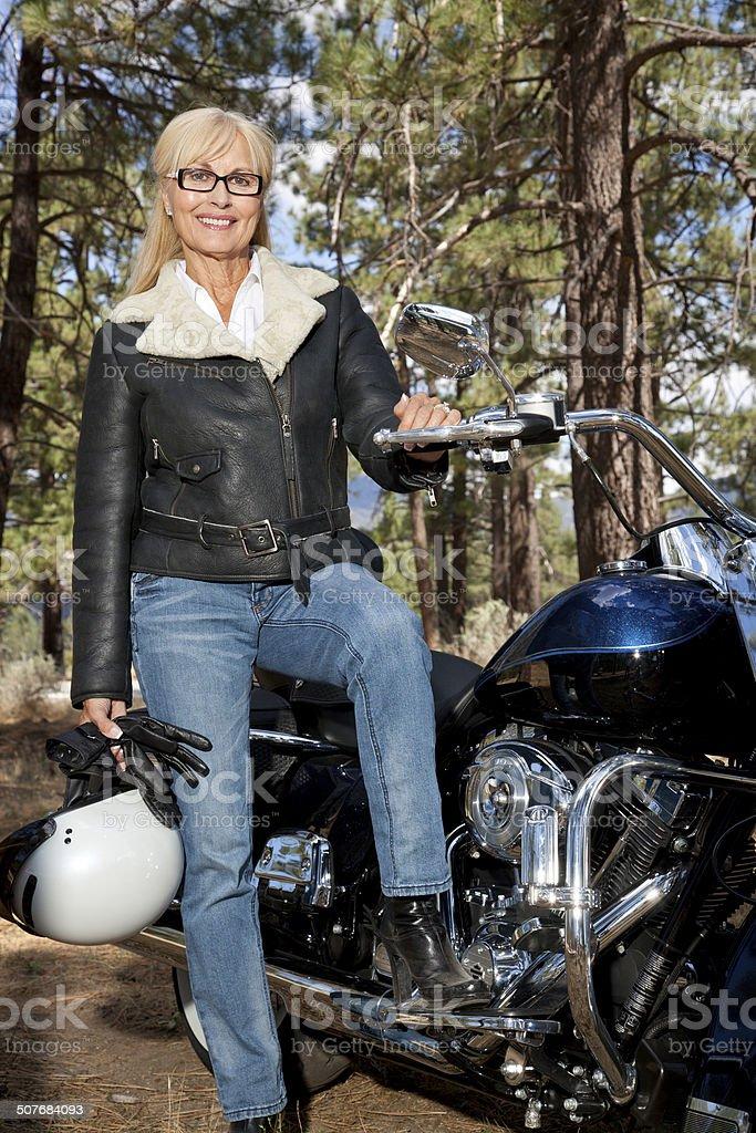 Senor couple with Motorcycle stock photo