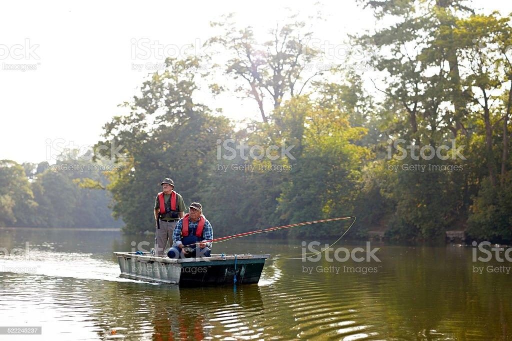 Senor men having a good time fishing stock photo