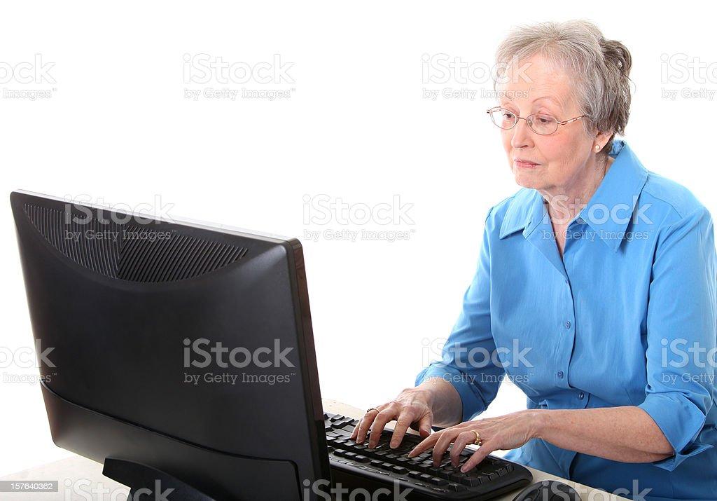 senor woman using a computer stock photo
