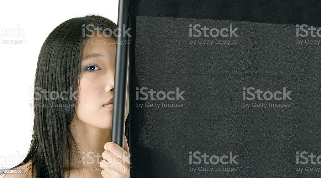 sensual asian girl bechind black folding screen stock photo