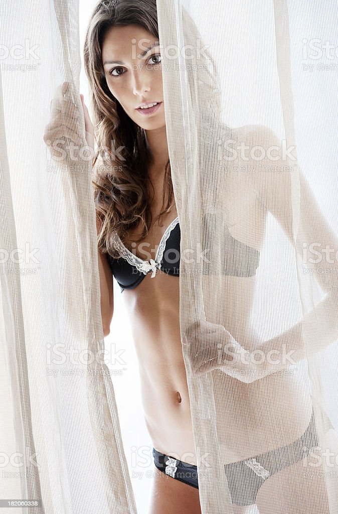 Sensual Beauty between the Curtains (XXXL) royalty-free stock photo
