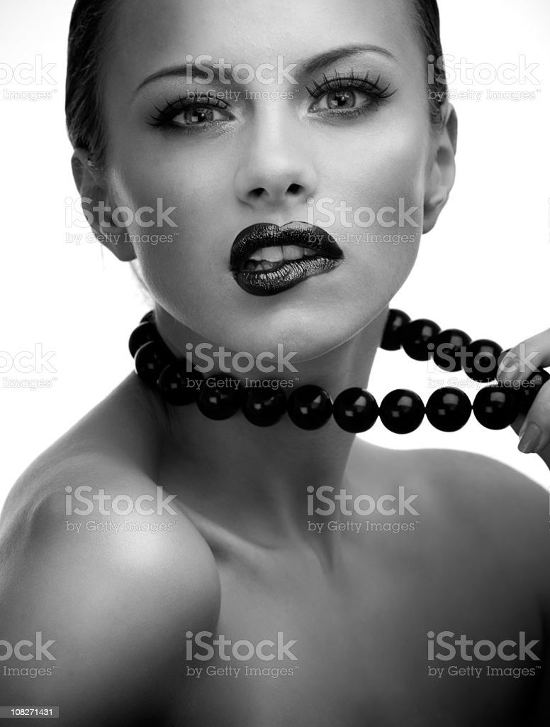 Sensual black and white studio portrait of young beautiful woman royalty-free stock photo