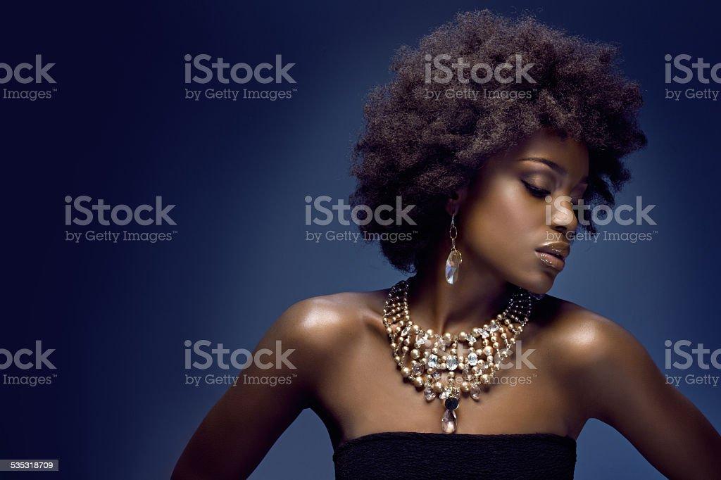 sensual black woman wearing luxury jewellery stock photo