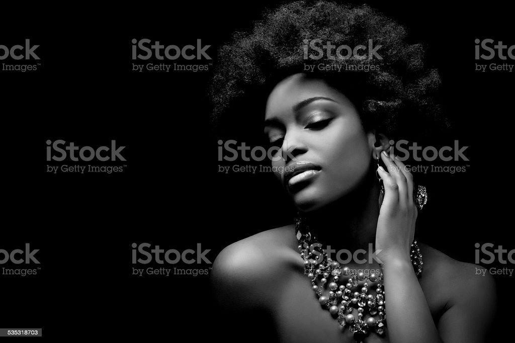 sensual black woman wearing luxury necklace stock photo