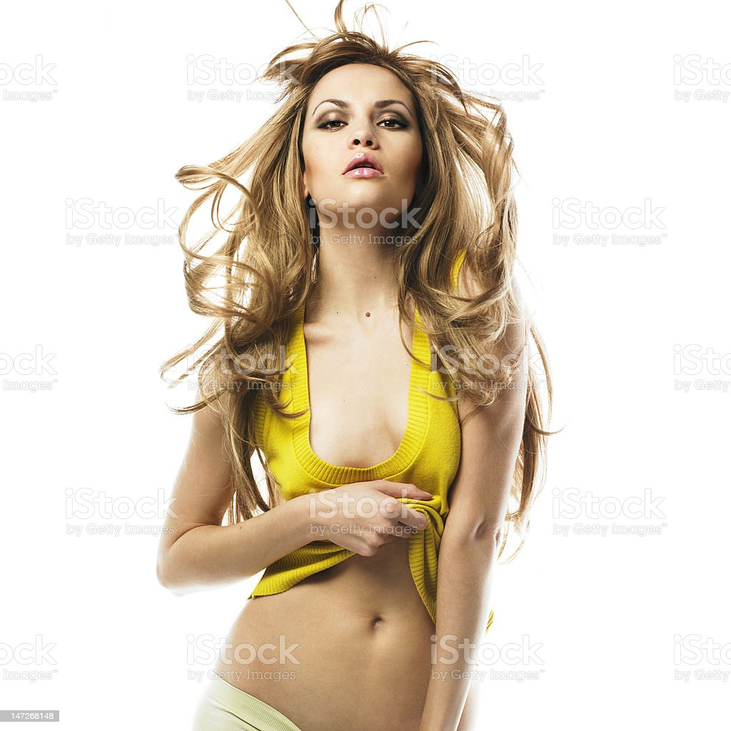 Sensual blond in a yellow shirt royalty-free stock photo