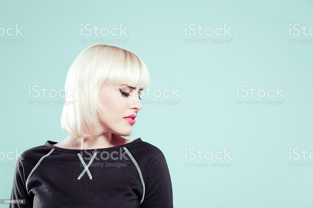 Sensual blonde young woman wearing black jumper stock photo