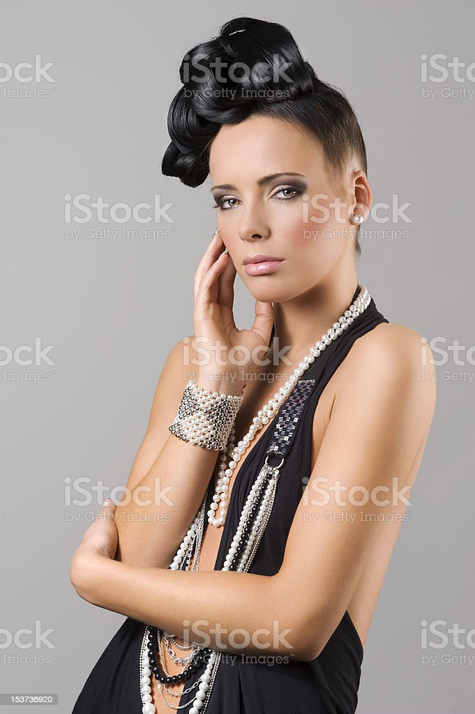 sensual brunette girl with necklace and hair style royalty-free stock photo
