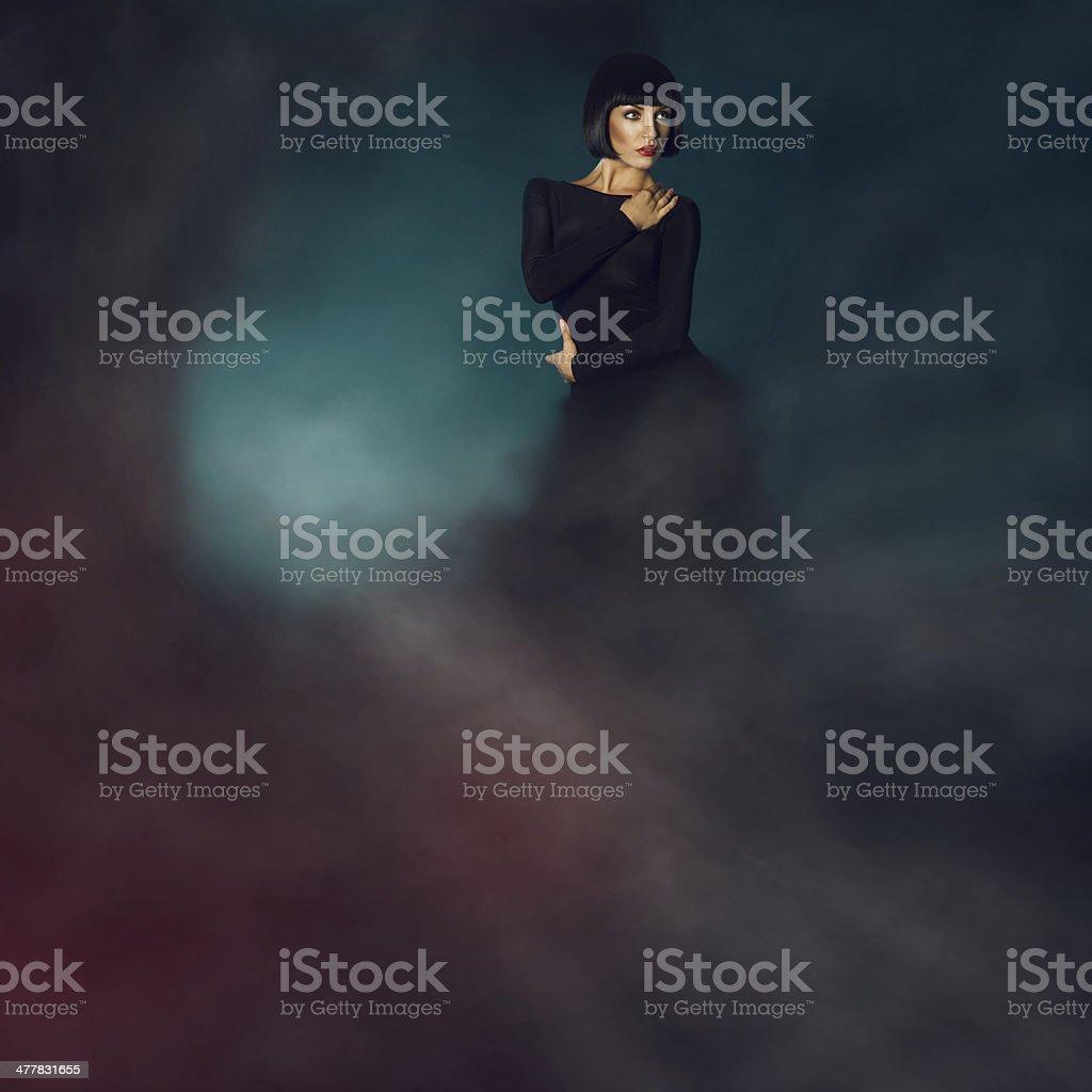 Sensual brunette in smoke royalty-free stock photo