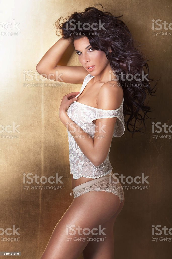 Sensual brunette woman posing in lingerie. stock photo