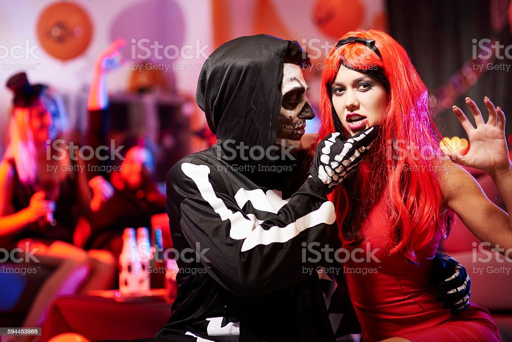 Sensual couple at halloween party stock photo