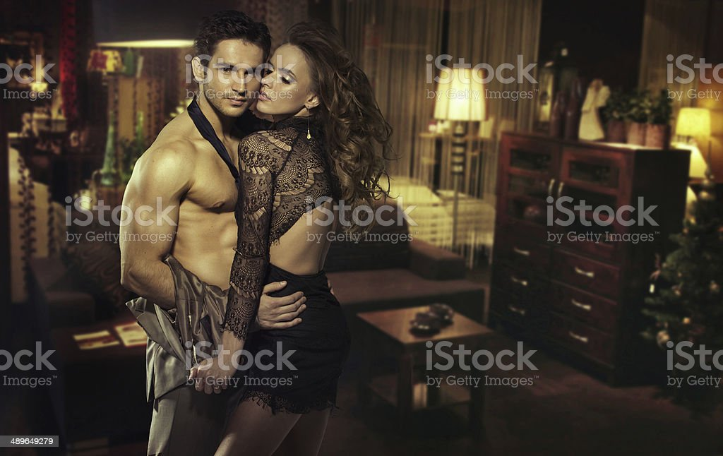 Sensual couple in romantic room stock photo