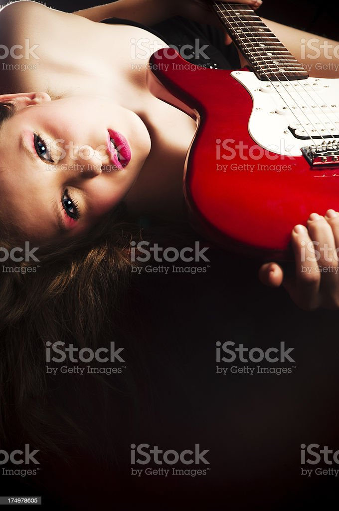 Sensual fashion model with electric guitar royalty-free stock photo