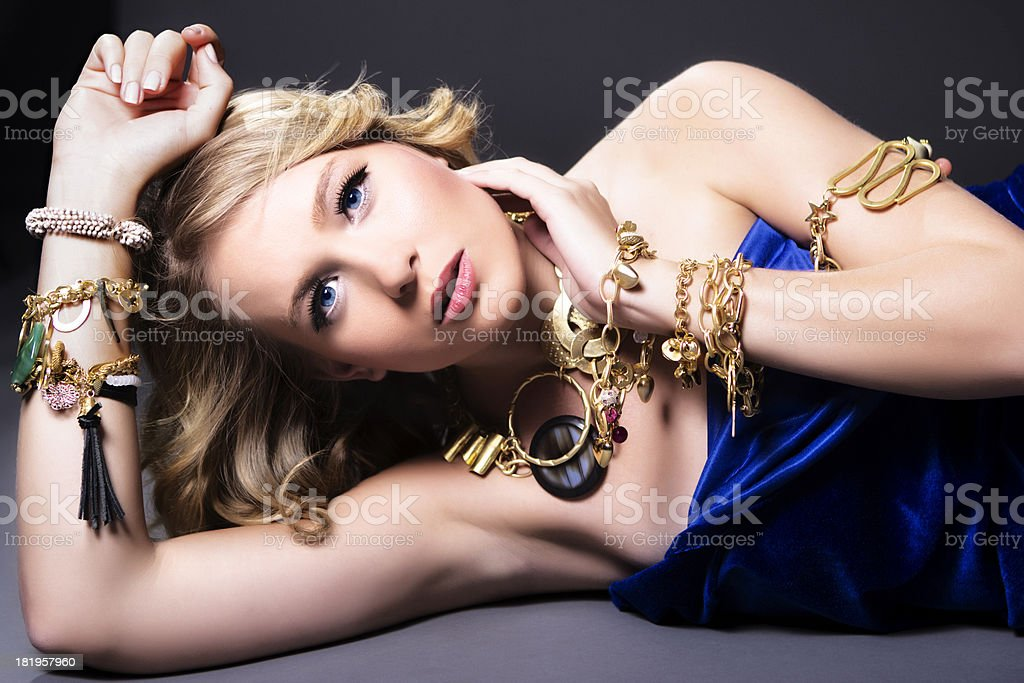 Sensual fashion model with gold jewelry royalty-free stock photo