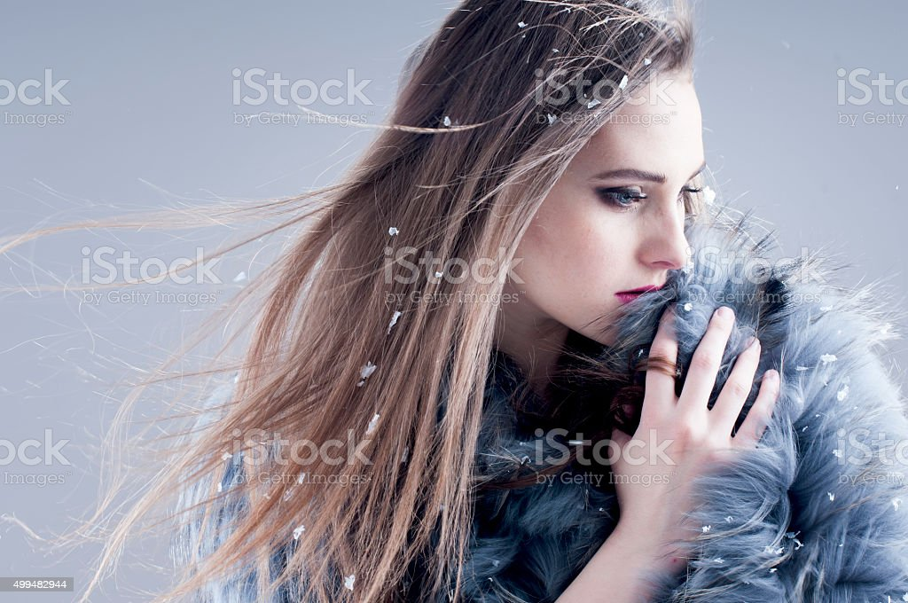 sensual girl in a fur coat stock photo