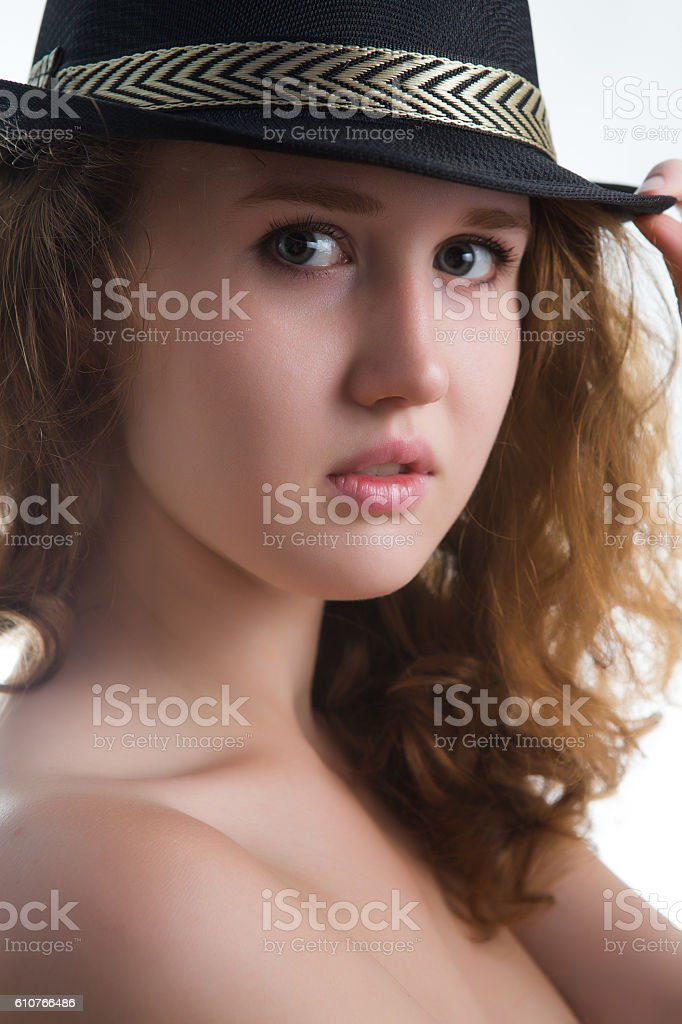 Sensual girl in a hat with a beautiful naked body. stock photo