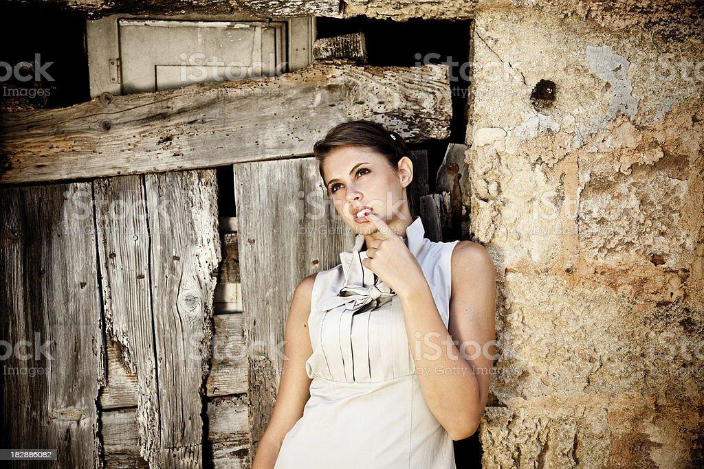Sensual Girl Next To A Wooden Door stock photo