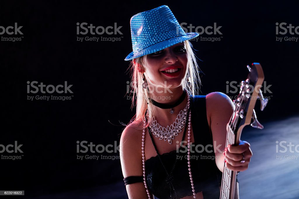 sensual girl playing on stage stock photo