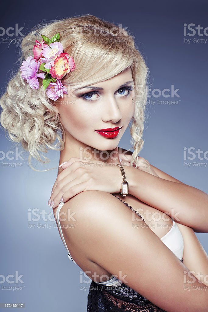 Sensual girl with red lips and flowers in her hair royalty-free stock photo